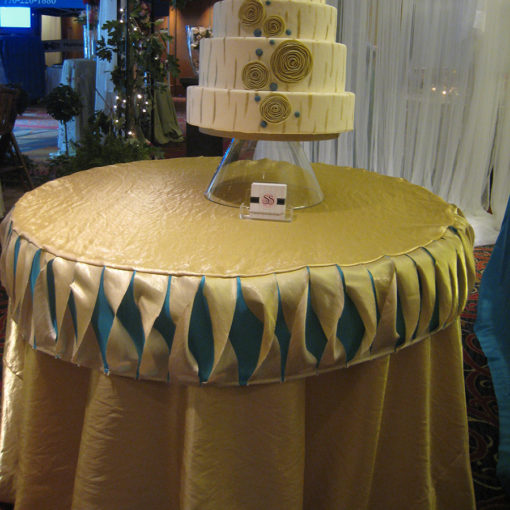 Gold and Turquoise Challis Cake table I Do Linens
